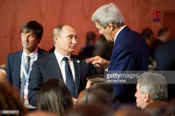 Secretary of State John Kerry speaks with Russian President Vladimir Putin during the opening ceremony of the World Climate Change Conference 2015 at...