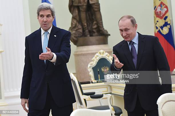 US Secretary of State John Kerry speaks with Russia's President Vladimir Putin during a meeting at the Kremlin in Moscow on December 15 2015 / AFP /...