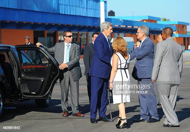 US Secretary of State John Kerry speaks with the Chief of Mission at the US Embassy in Havana Jeffrey DeLaurentis upon his arrival at Jose Marti...