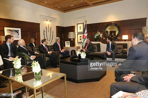 S Secretary of State John Kerry talks to King Abdullah II of Jordan during a meeting upon his arrival in Amman on January 5 2014 in Jordan