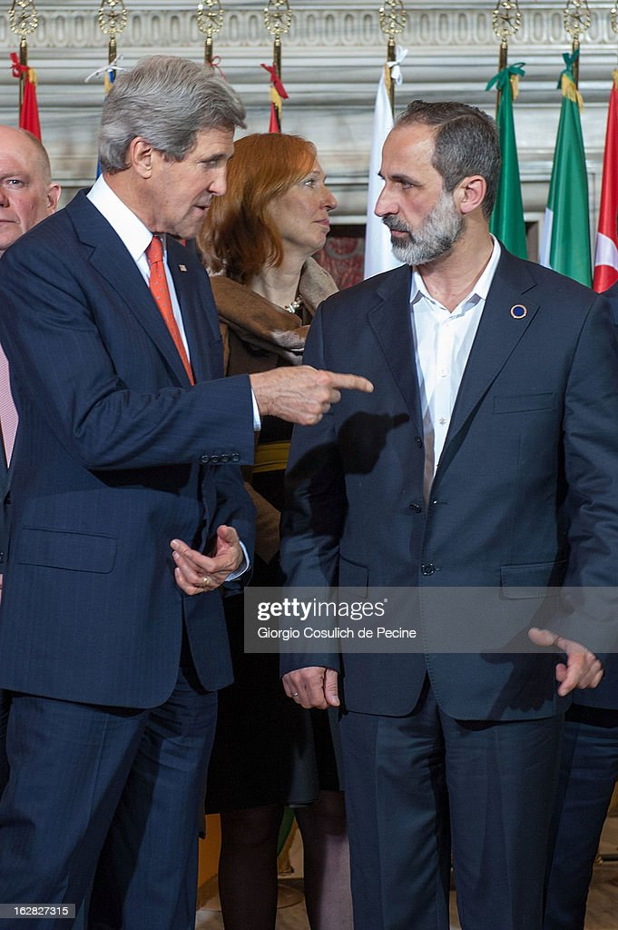 U.S. Secretary of State John Kerry (L) talks to the Syrian opposition's National Coalition chief Ahmed Moaz al-Khatib after a meeting of the 'Friends of the Syrian People at Villa Madama on February 28, 2013 in Rome, Italy. Kerry stated that the opposition needs 'more help' in the fight against President Bashar Hafez al-Assad. The new U.S. Secretary of State is on his first trip and is visiting nine nations in Europe and the Middle East.
