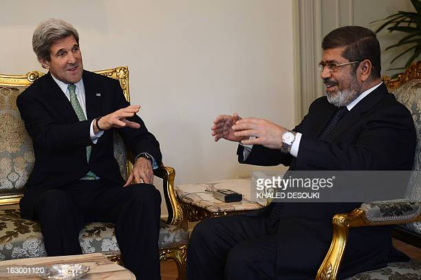 Secretary of State John Kerry talks with Egyptian President Mohamed Morsi at the presidential palace in Cairo on March 3, 2013. Kerry met the...