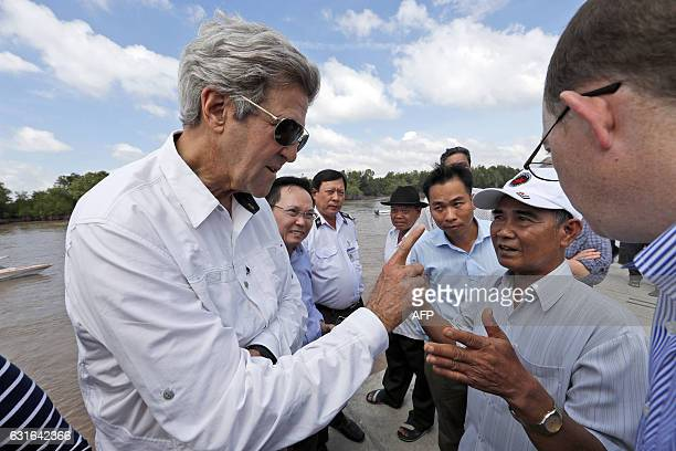 Secretary of State John Kerry talks with Vo Ban Tam who was a member of the former Viet Cong and who took part in the attack on Kerry's Swift Boat on...