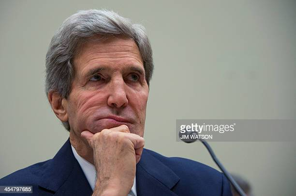 US Secretary of State John Kerry testifies before the House Foreign Relations Committee on Capitol Hill in Washington DC December 10 2013 Kerry...