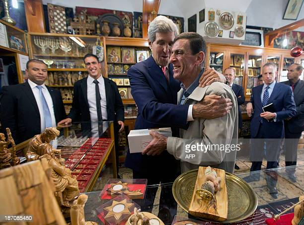 US Secretary of State John Kerry thanks Victor Tabash the owner of 'The Nativity Store' after being offered a baby Jesus figurine at Manger Square on...