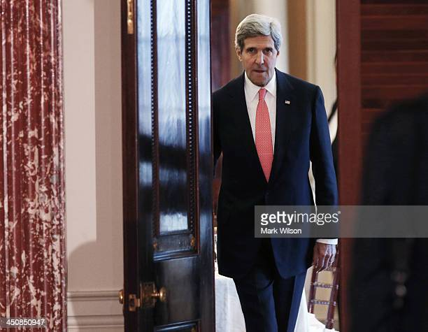 Secretary of State John Kerry walks into a news conference at the State Department, on November 20, 2013 in Washington, DC. Secretary Kerry and...