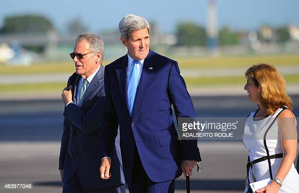 US Secretary of State John Kerry walks next to the Chief of Mission at the US Embassy in Havana Jeffrey DeLaurentis upon his arrival at Jose Marti...