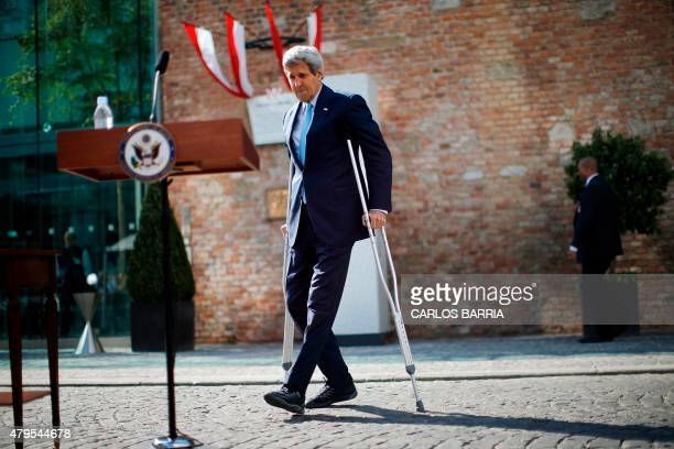 US Secretary of State John Kerry walks using crutches to deliver a statement on the Iran talks in Vienna Austria July 5 2015 The top US and Iranian...