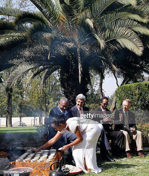 US Secretary of State John Kerry watches a coffee ceremony performed by Getenesh Abush in Addis Ababa May 26 2013 Kerry is in Addis Ababa as African...
