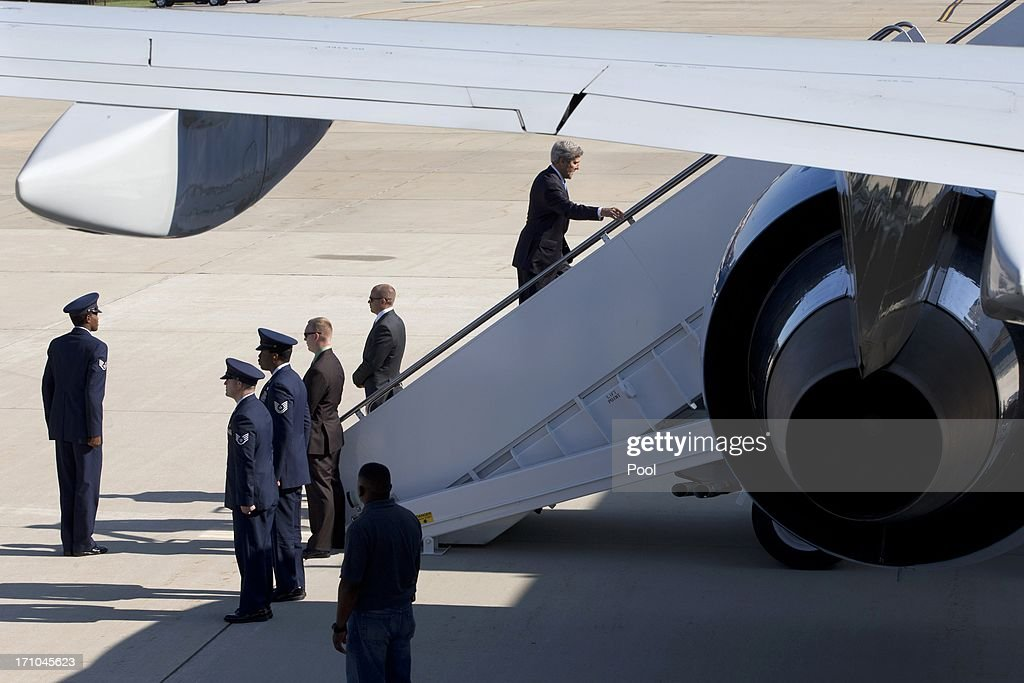 U.S. Secretary of State John Kerry waves as he boards his plane on June 21, 2013 at Andrews Air Force Base, Maryland. Kerry is en route to Doha for Syria talks.