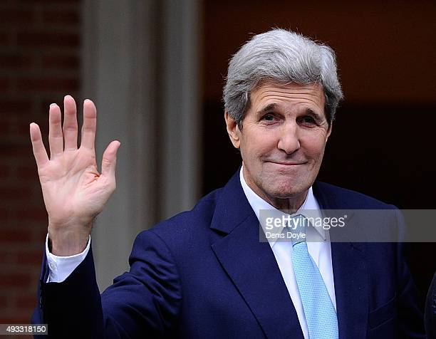 Secretary of State John Kerry waves before meeting with Spanish Prime Minister Mariano Rajoy at the Moncloa Palace on October 19, 2015 in Madrid,...