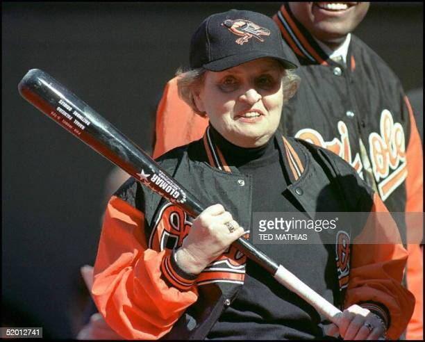 Secretary of State Madeleine Albright holds a bat before throwing out the first pitch before the game between the Kansas City Royals and the...