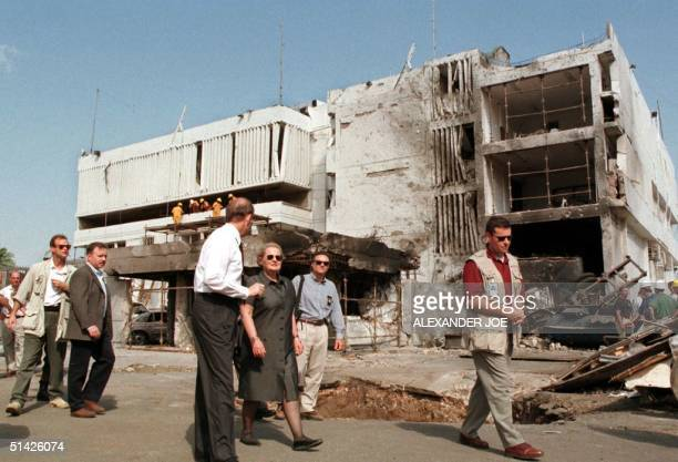 Secretary of State Madeleine Albright looks 18 August at damage from a bomb at the US embassy in Dar Es Salaam Tanzania where 10 people were killed...
