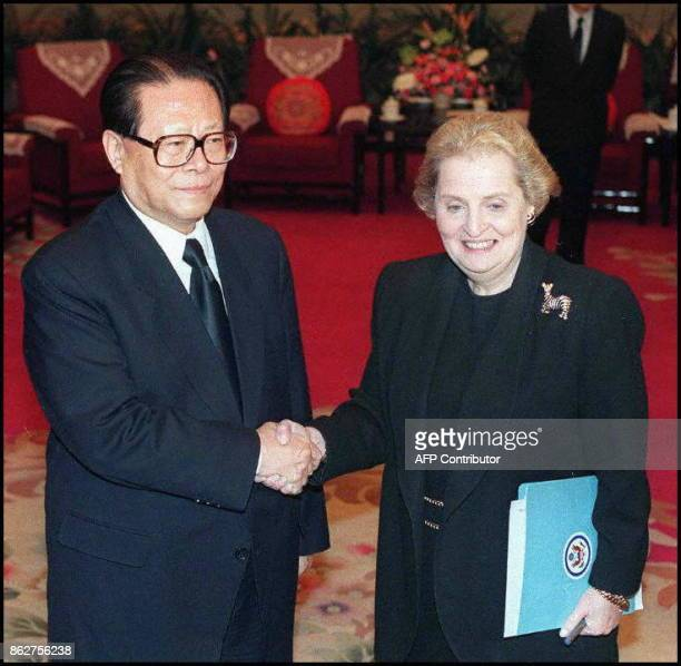 US Secretary of State Madeleine Albright shakes hands with Chinese President Jiang Zemin during a meeting at the Zhongnanhai leadership complex 24...