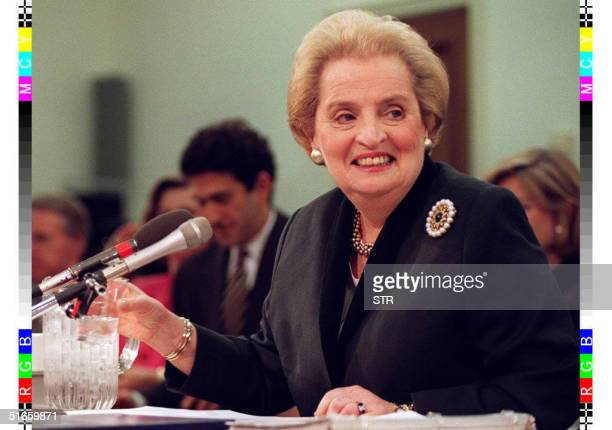 Secretary of State Madeleine Albright smiles as she prepares to testify before the House Appropriations Committee on Capitol Hill in Washington 12...