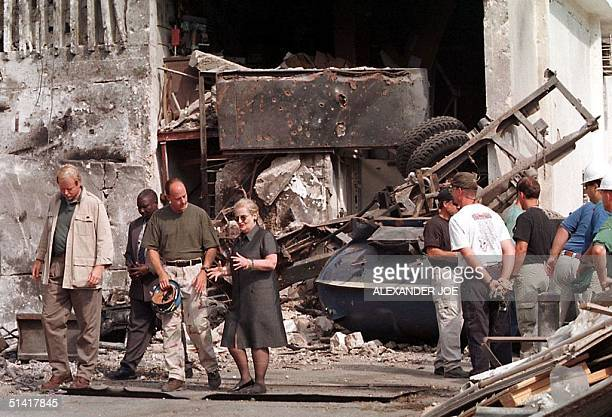 Secretary of State Madeleine Albright talks with a member of the FBI at the US embassy in Dar es Salaam where a bomb exploded 11 days ago leaving ten...