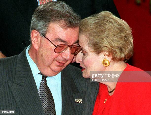 Secretary of State Madeleine Albright whispers in the ear of Russian Foreign Affairs Minister Yevgeny Primakov during a group photo session after...