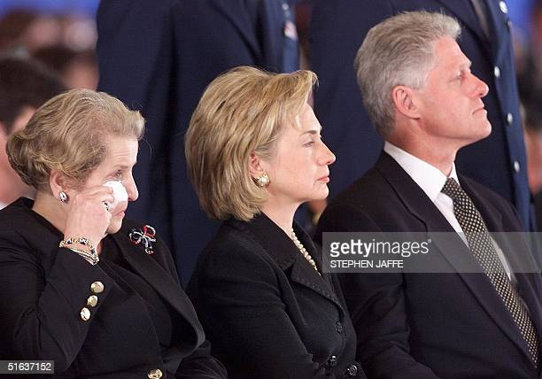 Secretary of State Madeleine Albright wipes a tear as she and US President Bill Clinton and Hillary Rodham Clinton attend a memorial ceremony 13...