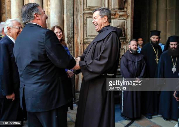 US Secretary of State Mike Pompeo accompanied by US ambassador to Israel David Friedman is greeted by Father Peter Vasko as he visits the Church of...