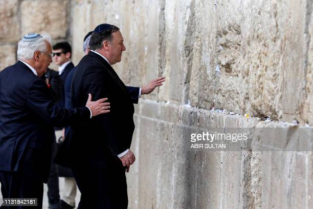 US Secretary of State Mike Pompeo accompanied by US ambassador to Israel David Friedman prepares to touch the stones of the Western Wall in...