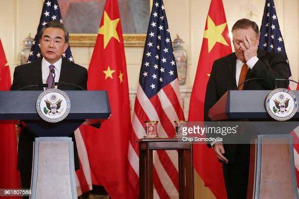 S Secretary of State Mike Pompeo and Chinese Foreign Minister Wang Yi hold a brief news conference in the Benjamin Franklin Room at the State...