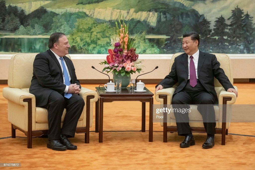 U.S. Secretary of State Mike Pompeo (L) and Chinese President Xi Jinping attend a meeting in the Great Hall of the People June 14, 2018 in Beijing, China.