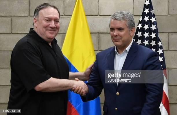 US Secretary of State Mike Pompeo and Colombian President Ivan Duque shake hands at the Tienditas International Bridge in Cucuta Norte del Santander...