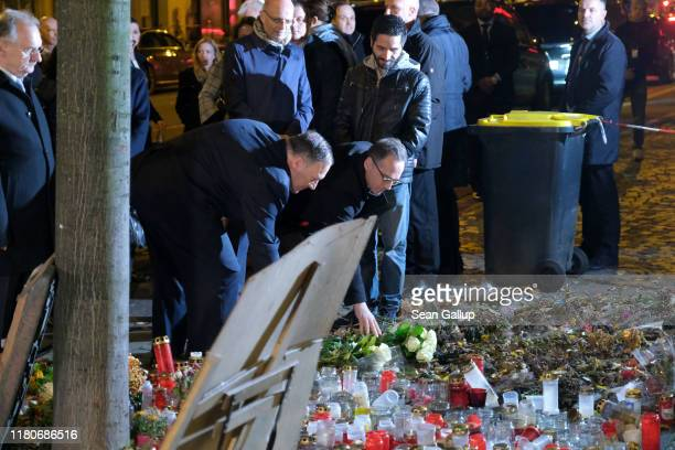 Secretary of State Mike Pompeo and German Foreign Minister Heiko Maas lay flowers outside a kebab restaurant, commemorating victims of an attempted...