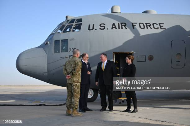 US Secretary of State Mike Pompeo and his wife Susan are welcomed by US ambassador to Iraq Douglas Silliman as they arrive in Baghdad during a Middle...