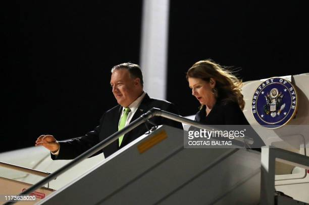 US Secretary of State Mike Pompeo and his wife Susan arrive at the Eleftherios Venizelos airport in Athens on October 4 2019 as part of Pompeo's...