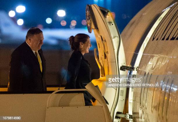 US Secretary of State Mike Pompeo and his wife Susan board their plane before departing for Cairo at Amman International airport in the Jordanian...