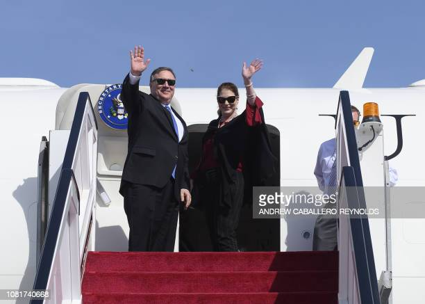 US Secretary of State Mike Pompeo and his wife Susan depart from Abu Dhabi International Airport in the UAE capital Abu Dhabi on January 13 2019