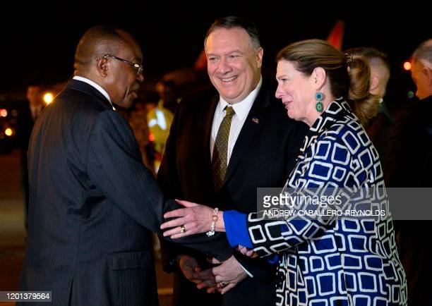 US Secretary of State Mike Pompeo and his wife Susan deplane as the Angolan Foreign Minister Manuel Domingos Augusto waits for them at 4 de Fevereiro...