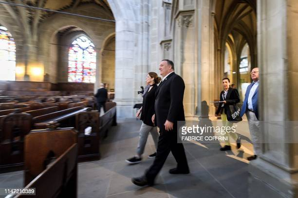 US Secretary of State Mike Pompeo and his wife Susan enter the Bern Minster cathedral during a visit on June 1 2019 in the Swiss capital Bern The US...