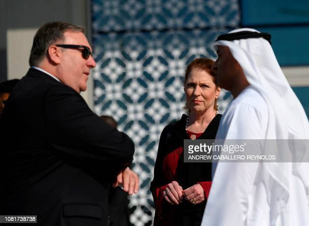 US Secretary of State Mike Pompeo and his wife Susan speak with the Emirati Ambassador to the US Yousef Al Otaiba at the NYU Abu Dhabi campus in Abu...