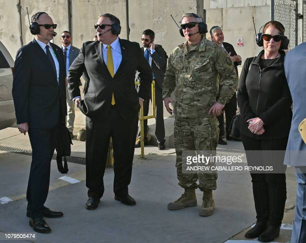 US Secretary of State Mike Pompeo and his wife Susan wait to board a helicopter to the US embassy at the terminal at Baghdad International Airport on...