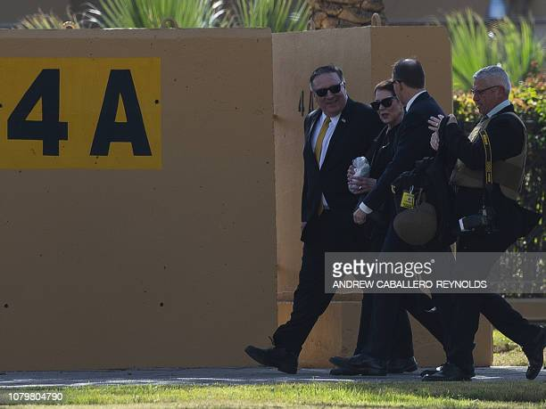 US secretary of State Mike Pompeo and his wife Susan walk at the US Embassy compound in the Iraqi capital Baghdad toward the heli pad to catch a...