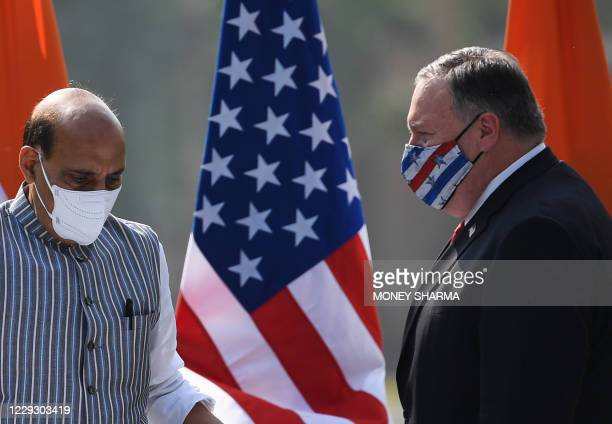 Secretary of State Mike Pompeo and India's Defence Minister Rajnath Singh arrive to address a joint press briefing in the lawns of Hyderabad House in...