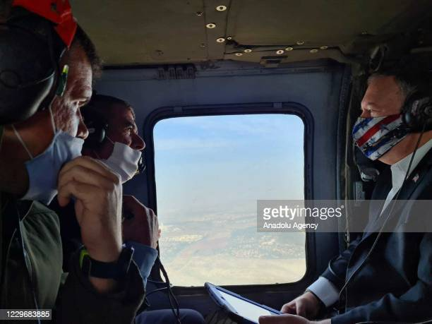 Secretary of State Mike Pompeo and Israeli Foreign Affairs Minister Gabi Ashkenazi inspect Golan Heights from a plane on November 19, 2020.