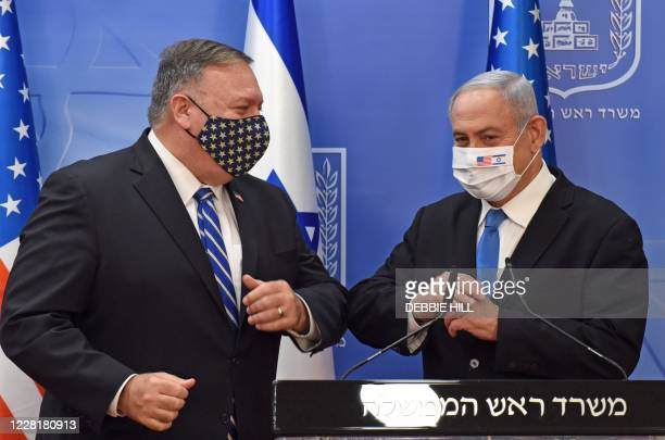 Secretary of State Mike Pompeo and Israeli Prime Minister Benjamin Netanyahu bump elbows ahead of making a joint statement to the press after meeting...