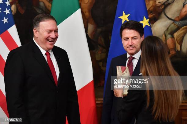 US Secretary of State Mike Pompeo and Italy's Prime Minister Giuseppe Conte react as Italian journalist Alice Martinelli from Italy's Mediaset...