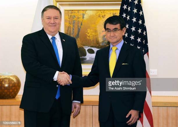 US Secretary of State Mike Pompeo and Japanese Foreign Minister Taro Kono shake hands prior to their meeting at the Foreign Ministry on October 6...