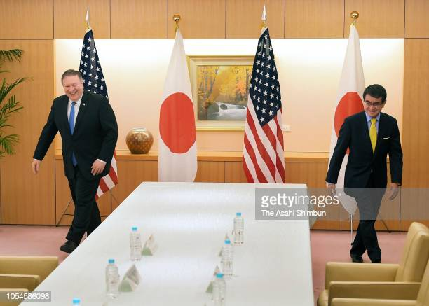 US Secretary of State Mike Pompeo and Japanese Foreign Minister Taro Kono walk to their seats prior to their meeting at the Foreign Ministry on...