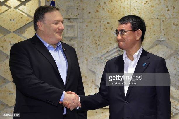 US Secretary of State Mike Pompeo and Japanese Foreign Minister Taro Kono shake hands prior to their working breakfast on July 8 2018 in Tokyo Japan