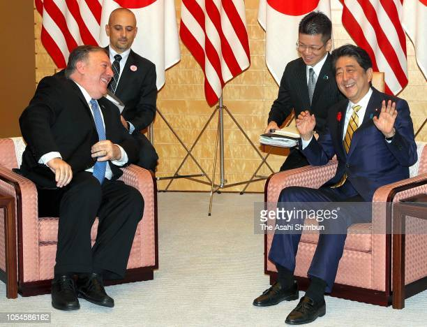 US Secretary of State Mike Pompeo and Japanese Prime Minister Shinzo Abe talk during their meeting at the prime minister's official residence on...