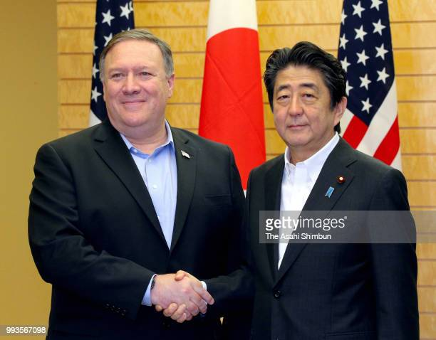 US Secretary of State Mike Pompeo and Japanese Prime Minister Shinzo Abe shake hands prior to their meeting at the prime minister's official...