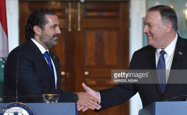 US Secretary of State Mike Pompeo and Lebanon's Prime Minister Saad Hariri shake hands as they speak to the press following a meeting at the State...