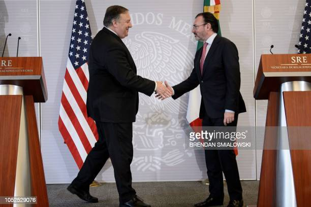 US Secretary of State Mike Pompeo and Mexico's Foreign Minister Luis Videgaray Caso shake hands after making statements to the press at the Ministry...