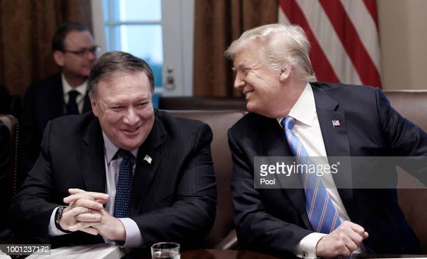 Secretary of State Mike Pompeo and President Trump share a laugh during a cabinet meeting with US President Donald Trump in the Cabinet Room of the...