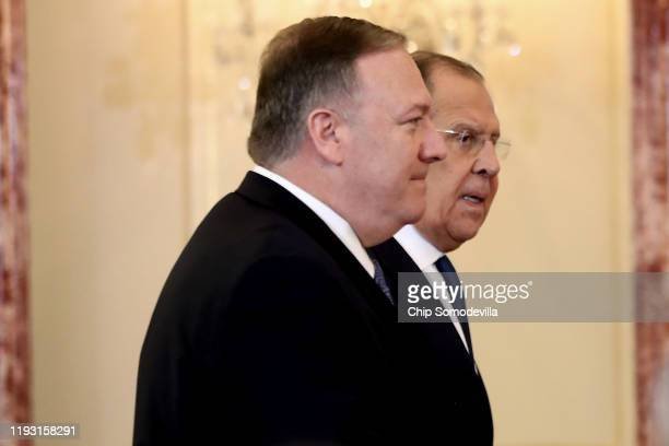 Secretary of State Mike Pompeo and Russian Foreign Minister Sergey Lavrov arrive for a joint news conference in the Franklin Room at the State...